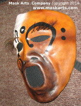 left side of the mask with a music note around the eye