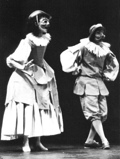 2 dancers in  masks cosume Arlecchinette and Arlecchino.. Black and white photo