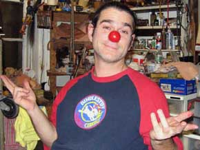 Keith Nelson trying on his finished clown nose for the first time