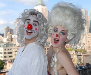 Mister and Missus Clown wearing clown noses and white hair