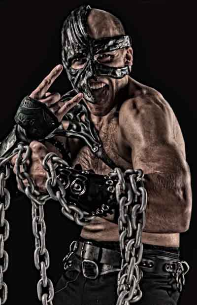 Magnos  wrestler with his custom mask and chains around his left arm.
